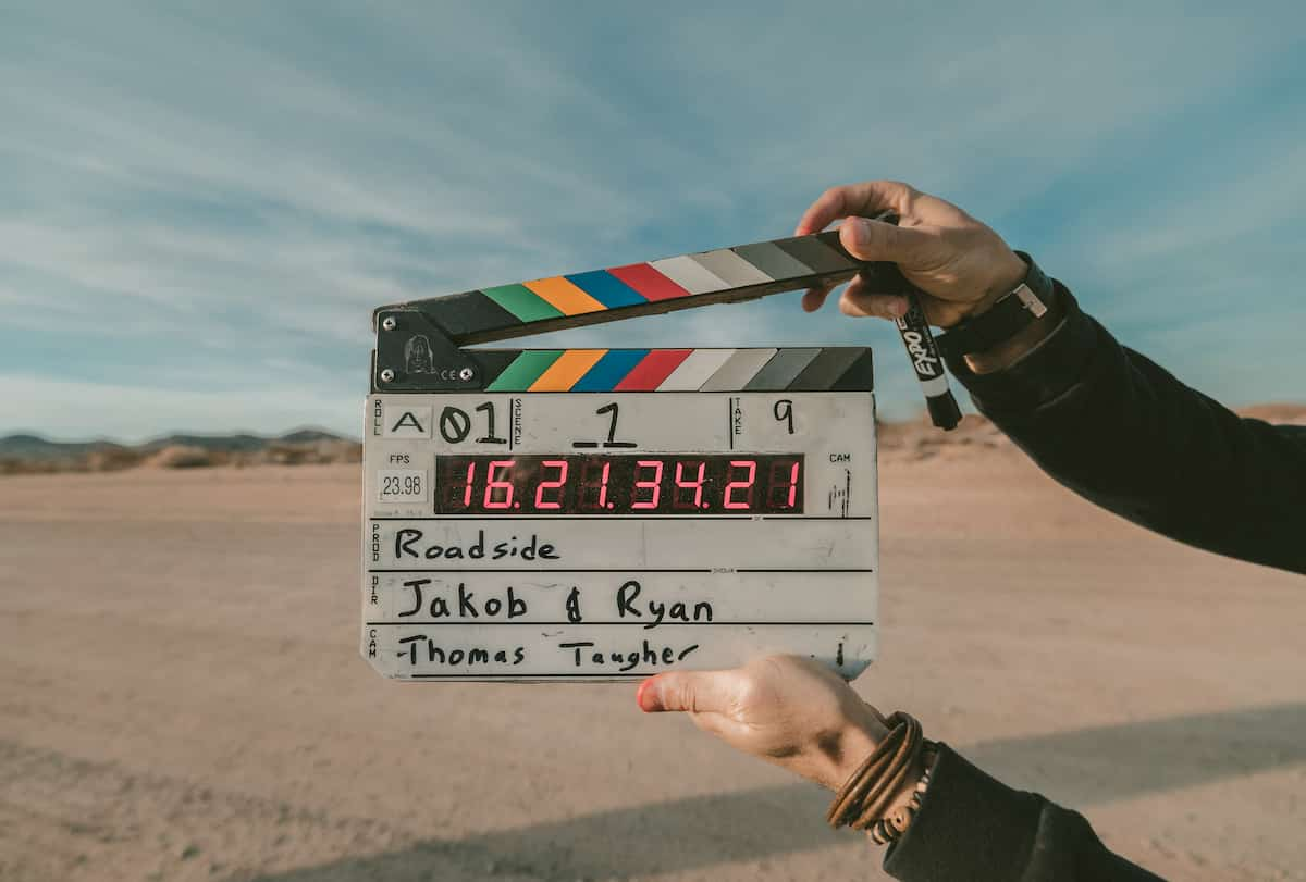 A film clap with desert on the background
