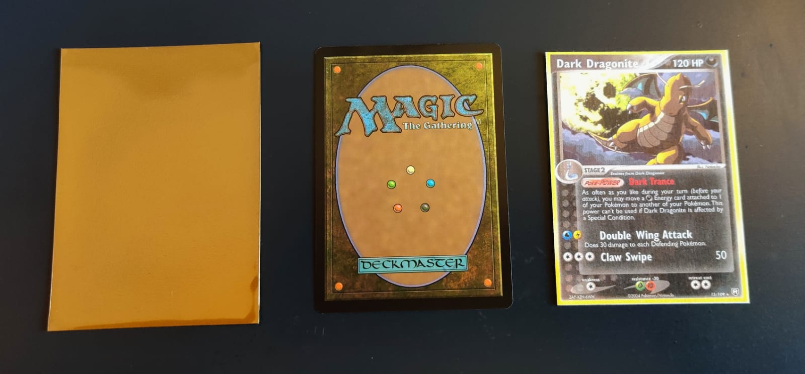 A card sleeve, a Magic the Gathering card upside down and a printed Dark Dragonite card