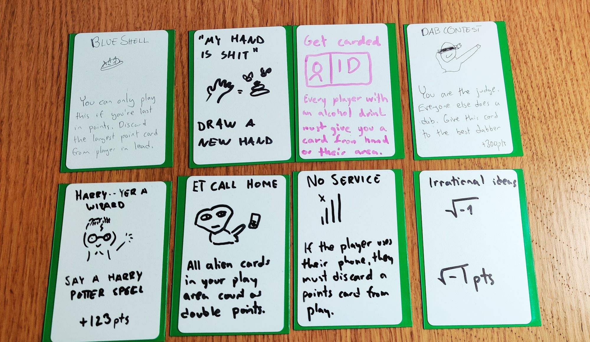Eight cards with handwritten test and pictures in two rows of 4