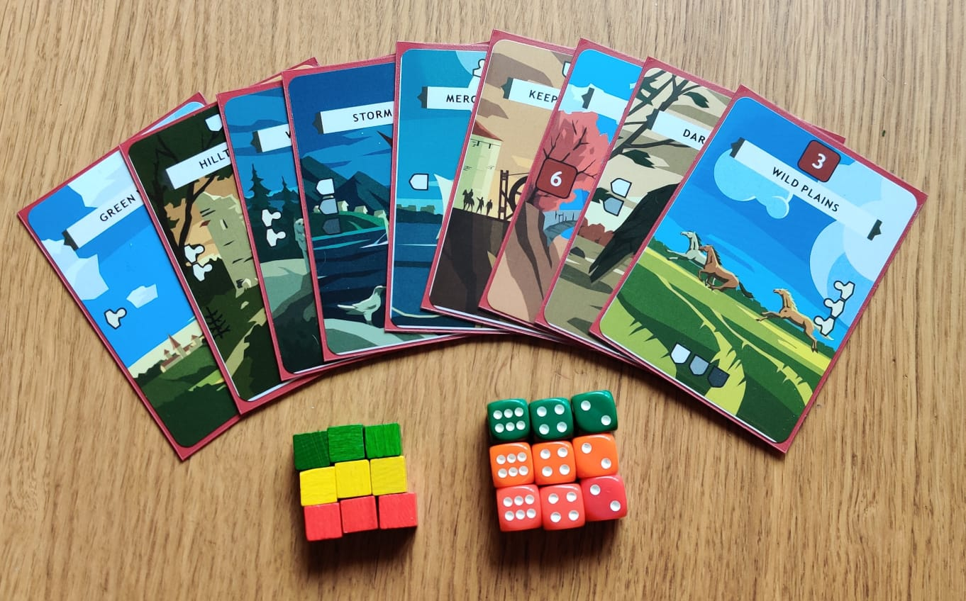 9 colorful and beautiful cards spread out in fan form with green, yellow and red cubes and dice at the bottom