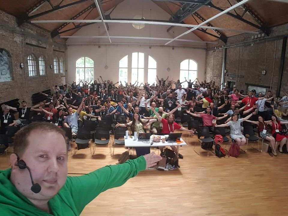 Me taking a selfie from PyCon CZ stage and everyone in audience spreading their arms to hug